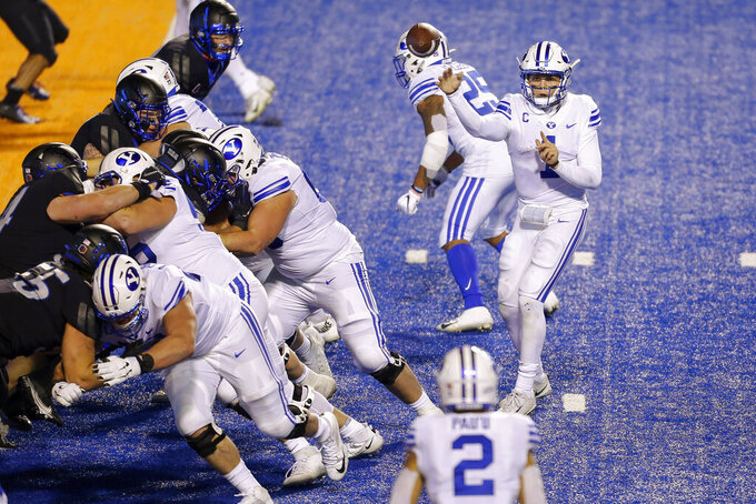 BYU quarterback Zach Wilson (1) throws the ball to BYU wide receiver Neil Pau'u (2) for a 1 yard touchdown against Boise State during the second half in an NCAA college football game Friday, Nov. 6, 2020, in Boise, Idaho. BYU won 51-17. (AP Photo/Steve Conner)