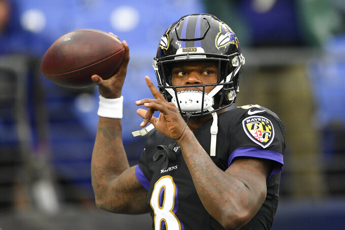 Baltimore Ravens quarterback Lamar Jackson warms up on the field before the start of an NFL football game against the San Francisco 49ers, Sunday, Dec. 1, 2019, in Baltimore, Md. (AP Photo/Nick Wass)