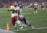 Washington Redskins running back Byron Marshall (34) scores a touchdown in front of New England Patriots defensive back Duron Harmon (21) during the first half of a preseason NFL football game, Thursday, Aug. 9, 2018, in Foxborough, Mass. (AP Photo/Charles Krupa)