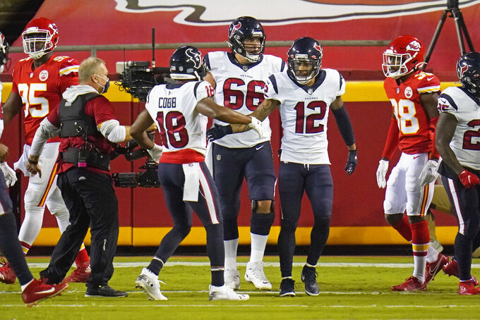 Houston Texans wide receiver Randall Cobb (18) celebrates with wide receiver Kenny Stills (12) and center Nick Martin (66) after the Texans scored a touchdown against the Kansas City Chiefs in the first half of an NFL football game Thursday, Sept. 10, 2020, in Kansas City, Mo. (AP Photo/Jeff Roberson)
