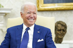 President Joe Biden smiles during his meeting with Iraqi Prime Minister Mustafa al-Kadhimi in the Oval Office of the White House in Washington, Monday, July 26, 2021. (AP Photo/Susan Walsh)