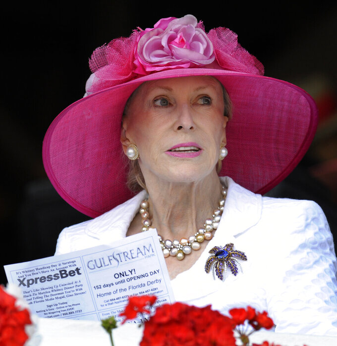 "FILE- In this Aug. 7, 2010, file photo, Marylou Whitney watches horse racing from her box seats at Saratoga Race Course in Saratoga Springs, N.Y. Philanthropist, socialite and horse-racing enthusiast Marylou Whitney, known as the ""Queen of Saratoga,"" died on July 19, 2019, at her Saratoga Springs estate after a long illness. She was 93. (AP Photo/Hans Pennink, File)"