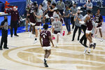 Mississippi State players and coaches celebrate after beating Kentucky in an NCAA college basketball game in the Southeastern Conference Tournament Thursday, March 11, 2021, in Nashville, Tenn. (AP Photo/Mark Humphrey)