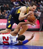 Indiana Pacers forward Bojan Bogdanovic steals the ball away from Detroit Pistons guard Wayne Ellington (20) during the first half of an NBA basketball game, Wednesday, April 3, 2019, in Detroit. (AP Photo/Carlos Osorio)
