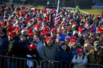 Supporters wait outside the airport before President Donald Trump speaks at a campaign rally Friday, Oct. 30, 2020, in Rochester, Minn. (AP Photo/Bruce Kluckhohn)