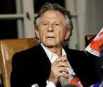 FILE - In this Oct. 30, 2015, file photo, filmmaker Roman Polanski tells reporters he can