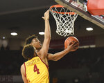 Oklahoma guard Alondes Williams shoots next to Iowa State forward George Conditt IV (4) during the second half of an NCAA college basketball game in Norman, Okla., Wednesday, Feb. 12, 2020. (AP Photo/Kyle Phillips)