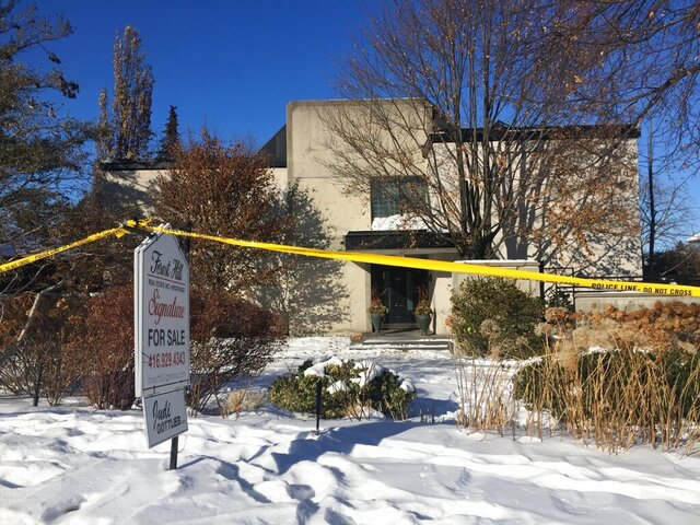 FILE - This Jan. 6, 2018 file photo, shows police crime scene tape marking off the property belonging to Barry and Honey Sherman, who were found strangled inside their home on Dec. 15, 2017. Toronto police said on Wednesday, Nov. 25, 2020, that they have identified a person of interest in the murders of the Shermans nearly three years ago. (AP Photo/Rob Gillies, File)