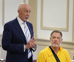 Michael Barisone, right, listens as his attorney Jeffrey Simms speaks in court in Morristown, N.J., Wednesday, Aug. 14, 2019. The former Olympian was charged with shooting and wounding a woman at a farm where he trained other riders will be detained pending trial. Barisone appeared in court Wednesday, a week after the shooting at his training center in Morris County. The judge said Barisone was still a danger to others.  (AP Photo/Seth Wenig)