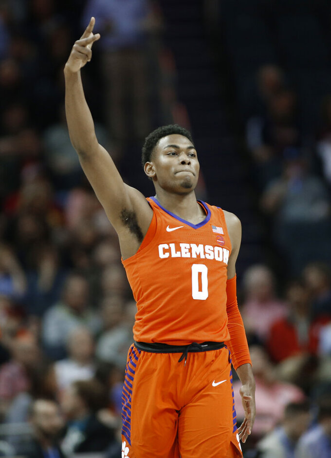 Clemson's Clyde Trapp (0) reacts after making a basket against North Carolina State during the first half of an NCAA college basketball game in the Atlantic Coast Conference tournament in Charlotte, N.C., Wednesday, March 13, 2019. (AP Photo/Nell Redmond)