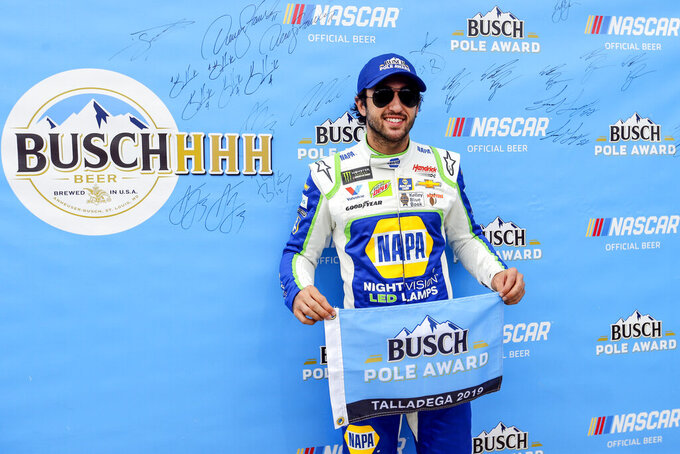 Monster Energy NASCAR Cup Series driver Chase Elliott (9) wins the pole for the 1000Bulbs.com 500 at Talladega Superspeedway, Saturday, Oct 12, 2019, in Talladega, Ala. (AP Photo/Butch Dill)