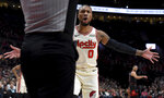 Portland Trail Blazers guard Damian Lillard reacts to an official's call during the first quarter of an NBA basketball game against the Chicago Bulls in Portland, Ore., Friday, Nov. 29, 2019. (AP Photo/Steve Dykes)