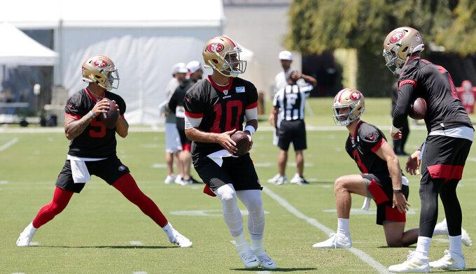 San Francisco 49ers quarterback Trey Lance and quarterback Jimmy Garoppolo looks to pass during NFL football practice in Santa Clara, Calif., Wednesday, June 2, 2021. (AP Photo/Josie Lepe)
