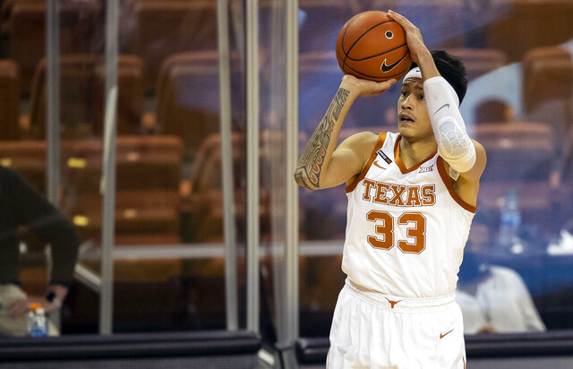 Texas forward Kamaka Hepa (33) shoots and scores against Kansas State in the second half of an NCAA college basketball game Saturday, Jan. 16, 2021, in Austin, Texas. (Ricardo B. Brazziell/Austin American-Statesman via AP)