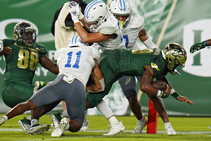 South Florida quarterback Noah Johnson (0) dives past Citadel defensive back Parrish Gordon (11) for a touchdown during the first half of an NCAA college football game Saturday, Sept. 12, 2020, in Tampa, Fla. (AP Photo/Chris O'Meara)