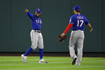 Texas Rangers center fielder Delino DeShields gestures next to right fielder Shin-Soo Choo after making the catch at the wall on a ball hit by Los Angeles Angels' Brian Goodwin during the third inning of a baseball game Wednesday, Aug. 28, 2019, in Anaheim, Calif. (AP Photo/Mark J. Terrill)