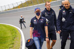 Red Bull driver Max Verstappen of the Netherlands walks the track ahead of Sunday's Formula One Dutch Grand Prix at the Zandvoort racetrack, Netherlands, Thursday, Sept. 2, 2021. (AP Photo/Francisco Seco)