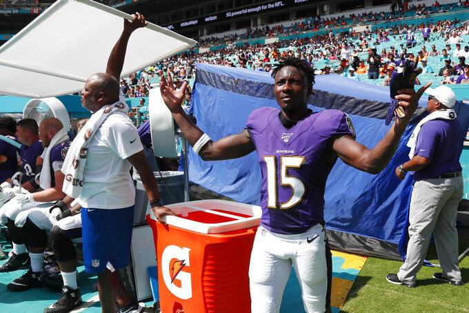 Baltimore Ravens wide receiver Marquise Brown (15) gestures during the last minutes of the second half at an NFL football game against the Miami Dolphins, Sunday, Sept. 8, 2019, in Miami Gardens, Fla. The Ravens defeated the Dolphins 59-10. (AP Photo/Wilfredo Lee)