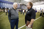 FILE - In this March 27, 2015, file photo, Gil Brandt, left, talks with TCU head coach Gary Patterson at the team's practice facility as some players work out for scouts at NFL football Pro Day in Fort Worth, Texas. Brandt will be inducted into the Pro Football Hall of Fame in Canton, Ohio on Aug. 3, 2019. (AP Photo/Tony Gutierrez, File)