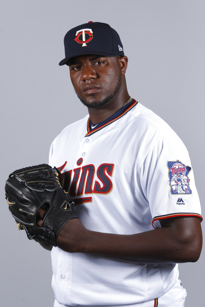 FILE - This 2018 file photo shows Michael Pineda of the Minnesota Twins baseball team. The Twins signed Pineda more than a year before he'll be cleared to pitch, aiming for what could be a bargain for the rotation this season if the big right-hander bounces back from elbow surgery.(AP Photo/John Minchillo, File)