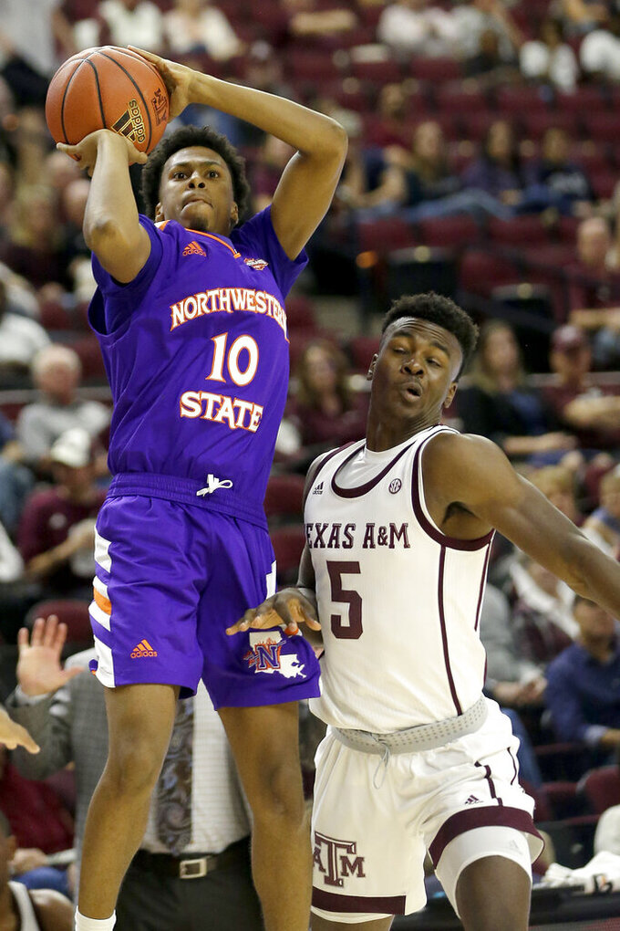 Northwestern State guard Jairus Roberson (10) shoots over Texas A&M forward Emanuel Miller (5) during the first half of an NCAA college basketball game Wednesday, Nov. 6, 2019, in College Station, Texas. (AP Photo/Sam Craft)