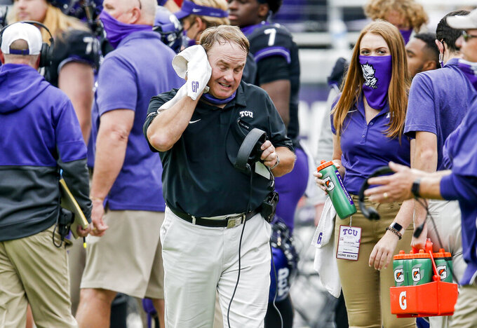 TCU head coach Gary Patterson wipes sweat from his face during the second half of an NCAA college football game against Oklahoma, Saturday, Oct. 24, 2020, in Fort Worth, Texas. (AP Photo/Brandon Wade)