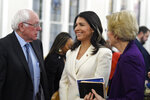US. Sen. Bernie Sanders, left, I-Vt.,greets U.S. Rep. Tulsi Gabbard, center, D-Hawaiiand Sen. Elizabeth Warren, right, D--Mass., speak at a Martin Luther King Jr. Day services at Zion Baptist Church, Monday, Jan. 20, 2020, in Columbia, S.C. (AP Photo/Meg Kinnard)