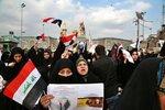 Shiite Muslims demonstrate over the U.S. airstrike that killed Iranian Revolutionary Guard Gen. Qassem Soleimani, in the posters, in Karbala, Iraq, Saturday, Jan. 4, 2020. Iran has vowed