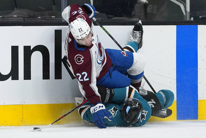 Colorado Avalanche defenseman Conor Timmins (22) collides with San Jose Sharks center Dylan Gambrell (7) during the second period of an NHL hockey game in San Jose, Calif., on Wednesday, May 5, 2021. (AP Photo/Tony Avelar)
