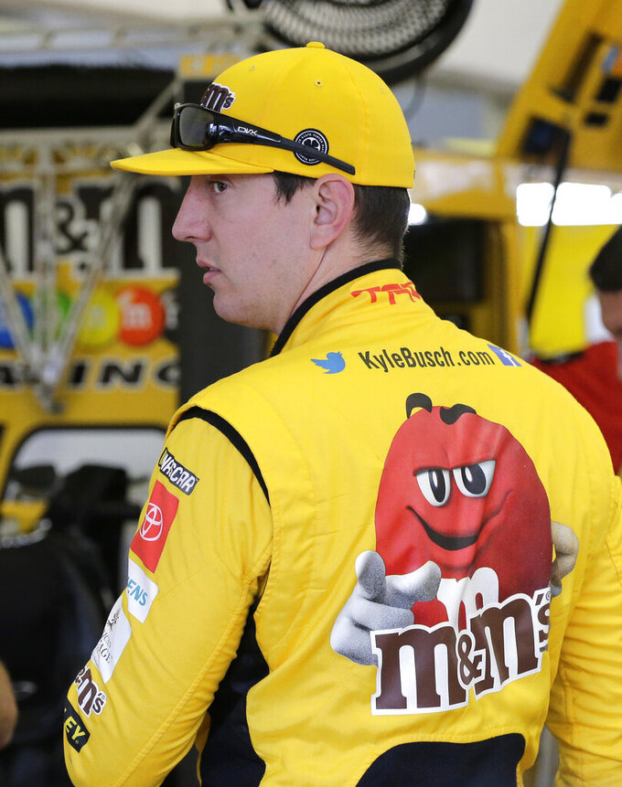 Kyle Busch waits in the garage for a NASCAR Cup Series auto race practice to begin on Friday, Nov. 15, 2019, at Homestead-Miami Speedway in Homestead, Fla. Busch is one of four drivers racing for the series championship. (AP Photo/Terry Renna)