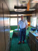 """McLaren CEO Zak Brown poses is his office, a 1972 Ford Condor RV he purchased in an online auction, at Laguna Seca Raceway in Monterey, Calif., Sunday, Sept. 19, 2021. What does champagne taste like when chugged from a dirty shoe?  Zak Brown doesn't know the answer to the question he's been most asked since McLaren broke a nine-year Formula One losing streak with a 1-2 sweep in Italy. Daniel Ricciardo celebrates his victories with a """"shoey"""" in which he fills his racing boot with champagne and turns the podium into a party. (AP Photo/Jenna Fryer)"""