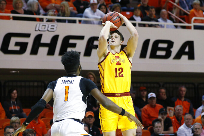 Iowa State forward Michael Jacobson (12) shoots over Oklahoma State guard Jonathan Laurent (1) in the second half of an NCAA college basketball game in Stillwater, Okla., Saturday, Feb. 29, 2020. (AP Photo/Sue Ogrocki)