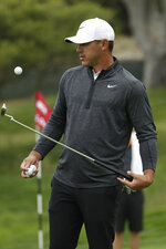 Brooks Koepka walks off the first green during a practice round for the U.S. Open Championship golf tournament Wednesday, June 12, 2019, in Pebble Beach, Calif. (AP Photo/Marcio Jose Sanchez)