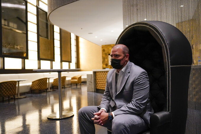 Jason Gannon, managing director of SoFi Stadium and Hollywood Park, sits in the champagne bar inside SoFi Stadium, the future home for the Los Angeles Rams and the Los Angeles Chargers NFL football teams, Friday, Sept. 4, 2020, in Inglewood, Calif. (AP Photo/Marcio Jose Sanchez)