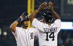 Detroit Tigers' Jeimer Candelario, left, is greeted by Christin Stewart after both scored on Candelario's two-run home run during the fourth inning of the team's baseball game against the Boston Red Sox, Saturday, July 6, 2019, in Detroit. (AP Photo/Carlos Osorio)