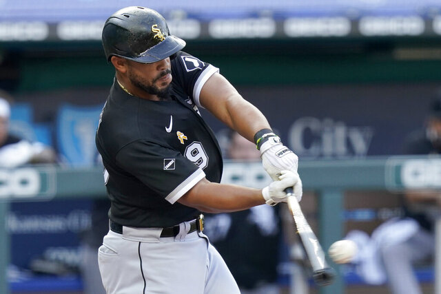 Chicago White Sox's Jose Abreu hits a two-run home run off Kansas City Royals starting pitcher Kris Bubic during the first inning of a baseball game at Kauffman Stadium in Kansas City, Mo., Saturday, Sept. 5, 2020. (AP Photo/Orlin Wagner)