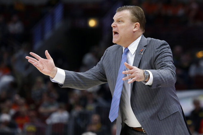 Illinois head coach Brad Underwood directs his team during the first half of an NCAA college basketball game against the Iowa in the second round of the Big Ten Conference tournament, Thursday, March 14, 2019, in Chicago. (AP Photo/Kiichiro Sato)