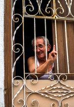 In this April 1, 2018 photo, Roberto Suarez Tagle speaks from his home in Santa Clara, Cuba.