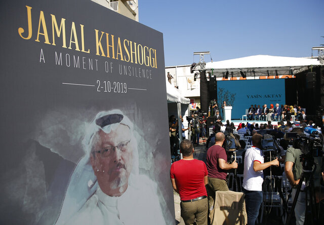 FILE - In this Oct. 2, 2019 file photo, a picture of slain Saudi journalist Jamal Kashoggi, is displayed during a ceremony near the Saudi Arabia consulate in Istanbul, marking the one-year anniversary of his death. Saudi Arabia's state television says final verdicts have been issued in the case of slain Washington Post columnist and Saudi critic Jamal Khashoggi after his family announced pardons that spared five from execution. The Riyadh Criminal Court issued final verdicts Monday, Sept. 7, 2020, against eight people. The court ordered a maximum sentence of 20 years in prison for five, with one receiving a 10-year sentence and two others being ordered to serve seven years in prison. The trial was widely criticized by rights groups and an independent U.N. investigator, who noted that no senior officials nor anyone suspected of ordering the killing was found guilty. (AP Photo/Lefteris Pitarakis, File)