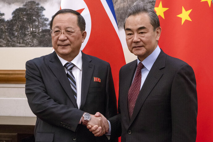 North Korean Foreign Minister Ri Yong Ho, left meets China's Foreign Minister Wang Yi at the Diaoyutai State Guesthouse in Beijing  Friday, Dec. 7, 2018. (Fred Dufour/Pool Photo via AP)