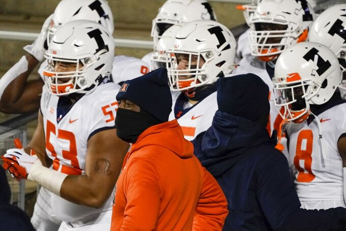 Illinois head coach Lovie Smith waits with his team to be introduced an NCAA college football game against Wisconsin Friday, Oct. 23, 2020, in Madison, Wis. (AP Photo/Morry Gash)