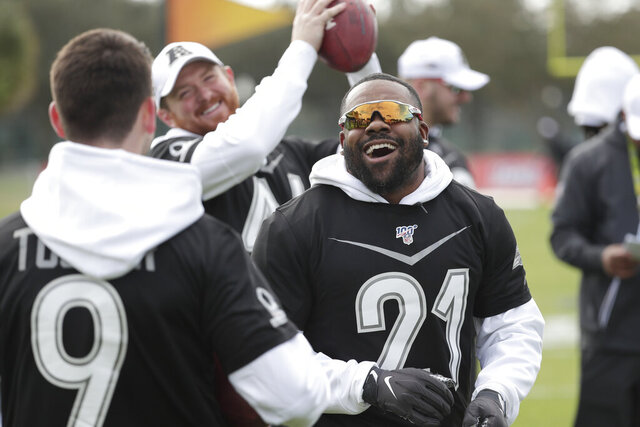 Baltimore Ravens kicker Justin Tucker (9), long snapper Morgan Cox, center, and running back Mark Ingram joke around during an NFC practice for the NFL Pro Bowl football game Wednesday, Jan. 22, 2020, in Kissimmee, Fla. (AP Photo/John Raoux)