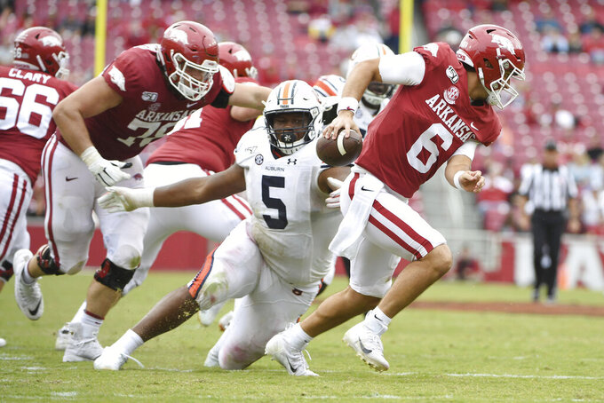 FILE - In this Oct. 19, 2019, file photo, Auburn defensive tackle Derrick Brown puts pressure on Arkansas quarterback Ben Hicks during an NCAA college football game in Fayetteville, Ark. Brown was a finalist for the Chuck Bednarik Award (top defensive player) and Outland Trophy (best lineman). (AP Photo/Michael Woods, File)