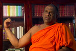 """In this Monday, Nov. 18, 2019, photo, Galagoda Aththe Gnanasara, a nationalist leader and monk, speaks to the Associated Press at his party headquarters in Colombo, Sri Lanka. """"We built an ideology that the country needs a Sinhala leader who does not bend down in front of minorities,"""" said Gnanasara, """"now that ideology has won."""" Gnanasara and other members of his Bodu Bala Sena, or Army of Buddhist Power, campaigned hard for new President Gotabaya Rajapaksa. Rajapaksa is a former defense official who is regarded by fellow Sinhalese Buddhists as a hero for his role in ending Sri Lanka's 26-year civil war with ethnic Tamil rebels. (AP Photo/Dar Yasin)"""