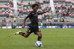 Venezia's Gianluca Busio kicks the ball during the Serie A soccer match between Venezia and Spezia, at the Pier Luigi Penzo stadium in Venice, Italy, Sunday, Sept. 19, 2021. Italian soccer team Venezia is back in the top division for the first time since 2002. And it has tapped Major League Soccer to recruit young Americans in its bid to stay afloat in Serie A. Nineteen-year-old Gianluca Busio arrived in Venice from Sporting Kansas City and 20-year-old Tanner Tessmann from FC Dallas. (Paola Garbuio/LaPresse via AP)