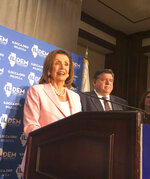 U.S. House Speaker Nancy Pelosi answers reporters' questions after keynoting the Illinois Democratic County Chairs' Association brunch Wednesday, August 14, 2019 at the Illinois State Fair in Springfield. The California Democrat exhorted about 2,200 Democrats at the event to defeat Republican President Donald Trump and give Democrats a U.S. Senate majority in 2020. (AP Photo/John O'Connor)