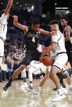 Wake Forest guard Torry Johnson (4) can't hang on to the ball as he drives against Georgia Tech guard Michael Devoe (0) during the first half of an NCAA college basketball game, Saturday, Jan. 5, 2019, in Atlanta. (AP Photo/John Bazemore)