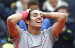 Cristian Garin of Chile celebrates defeating Italy's Matteo Berrettini in the final match of the ATP tennis tournament in Munich, Germany, Sunday, May 5, 2019. (AP Photo/Matthias Schrader)