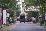 In this image made from video, a military truck is seen near the presidential palace in the capital Conakry, Guinea Sunday, Sept. 5, 2021. Mutinous soldiers detained President Alpha Conde on Sunday after hours of heavy gunfire rang out near the presidential palace, then announced on state television that the government had been dissolved in an apparent coup d'etat. (AP Photo)