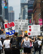 Thousands of people protest at an anti-racism demonstration reflecting anger at the police killings of black people in Toronto on Friday, June 5, 2020. (Nathan Denette/The Canadian Press via AP)